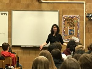 Author Rachel Hartman speaks to students in the Bennion Jr. High Media Center